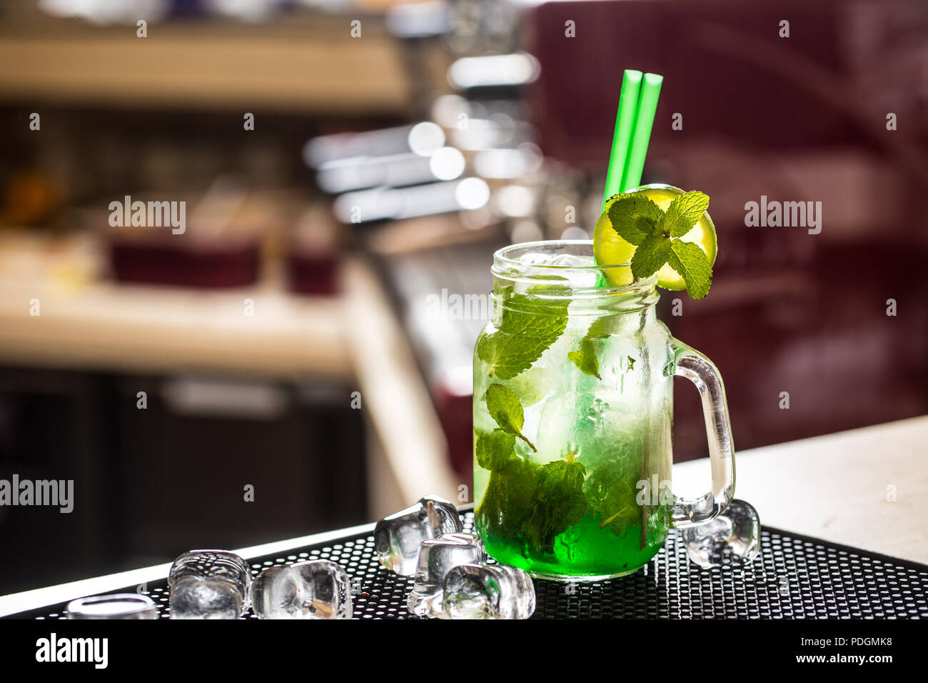 Mojito drink or lemonade with mint leaves on barcounter. - Stock Image