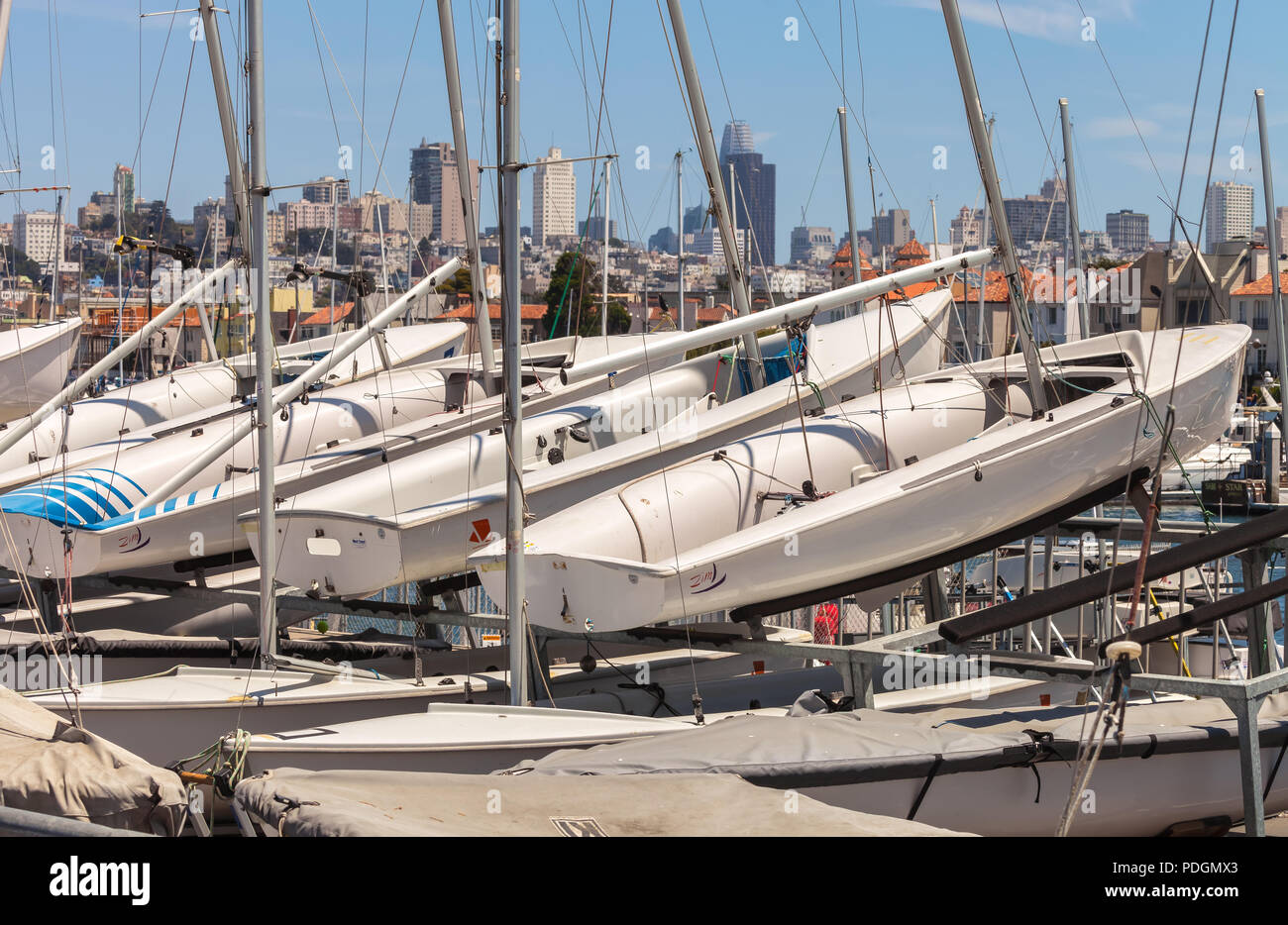 Sailboats on the rack at the Yacht Club in Marina, San Francisco, California, with the city in the background. - Stock Image
