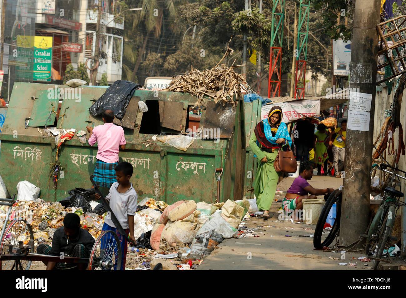 Garbage-littered on the streets is the common scenario in Dhaka, the capital city of Bangladesh. Dhaka, Bangladesh - Stock Image