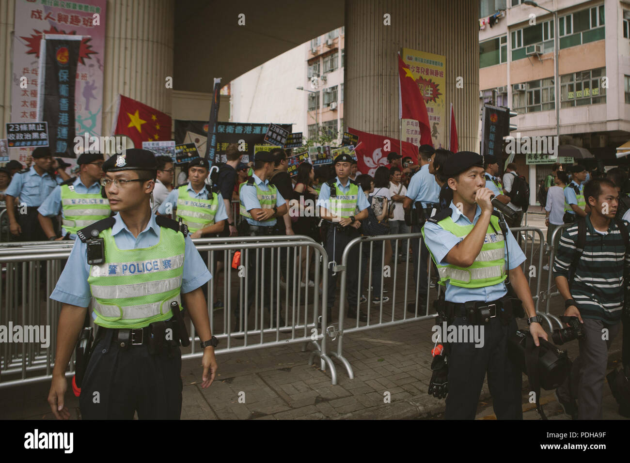 Hong Kong, Hong Kong. 30th June, 2017. Police staff seen around the area where the ceremony was held.Thousands came together and demonstrated to mark the 20th anniversary of the Handover from Britain to China, Hong Kong's return to China on July 1st 1997. The protestors marched through sun and rain from Victoria Park to Admiralty, taking a stand on a variety of human-rights-related causes. Credit: Viola Gaskell/SOPA Images/ZUMA Wire/Alamy Live News - Stock Image
