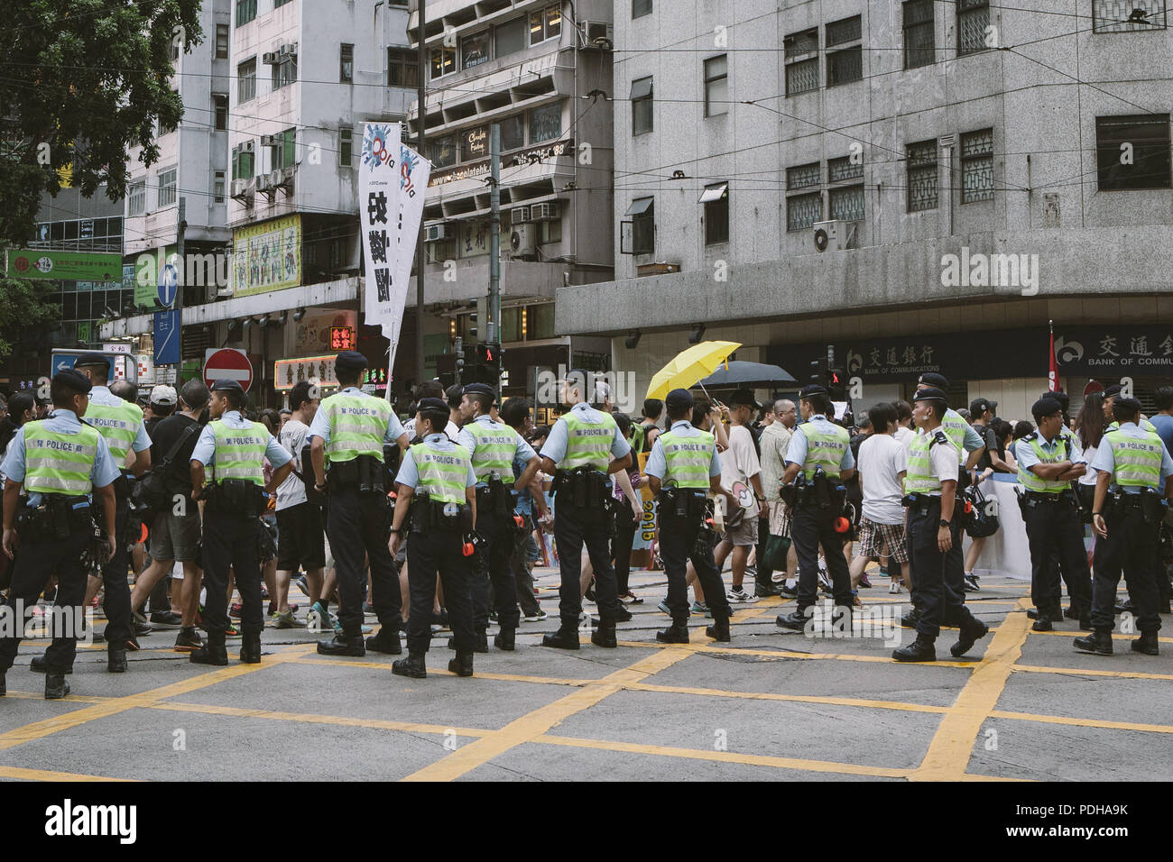 Hong Kong, Hong Kong. 1st July, 2017. Police seen monitoring the thousands of demonstrators marching.Thousands came together and demonstrated to mark the 20th anniversary of the Handover from Britain to China, Hong Kong's return to China on July 1st 1997. The protestors marched through sun and rain from Victoria Park to Admiralty, taking a stand on a variety of human-rights-related causes. Credit: Viola Gaskell/SOPA Images/ZUMA Wire/Alamy Live News - Stock Image