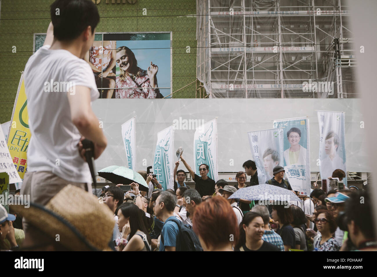 Hong Kong, Hong Kong. 1st July, 2017. People seen holding posters during the protest.Thousands came together and demonstrated to mark the 20th anniversary of the Handover from Britain to China, Hong Kong's return to China on July 1st 1997. The protestors marched through sun and rain from Victoria Park to Admiralty, taking a stand on a variety of human-rights-related causes. Credit: Viola Gaskell/SOPA Images/ZUMA Wire/Alamy Live News - Stock Image