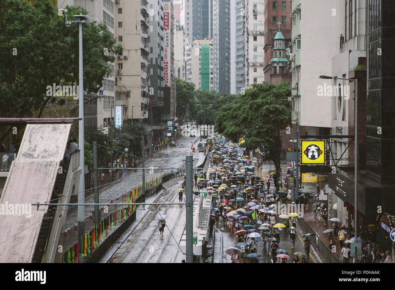 July 1, 2017 - Hong Kong, Hong Kong - Thousands of demonstrators seen marching through the streets of Hong Kong..Thousands came together and demonstrated to mark the 20th anniversary of the Handover from Britain to China, Hong Kong's return to China on July 1st 1997. The protestors marched through sun and rain from Victoria Park to Admiralty, taking a stand on a variety of human-rights-related causes. (Credit Image: © Viola Gaskell/SOPA Images via ZUMA Wire) - Stock Image