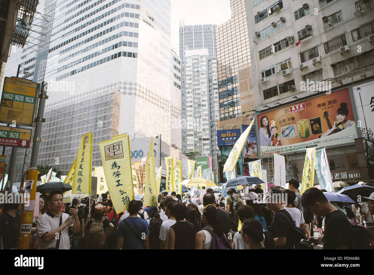 July 1, 2017 - Hong Kong, Hong Kong - People seen holding posters during the protest..Thousands came together and demonstrated to mark the 20th anniversary of the Handover from Britain to China, Hong Kong's return to China on July 1st 1997. The protestors marched through sun and rain from Victoria Park to Admiralty, taking a stand on a variety of human-rights-related causes. (Credit Image: © Viola Gaskell/SOPA Images via ZUMA Wire) - Stock Image