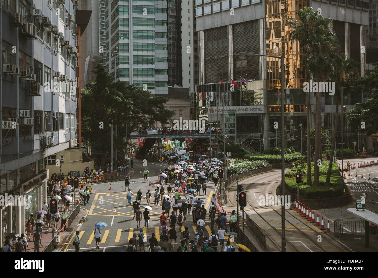 June 30, 2017 - Hong Kong, Hong Kong - Thousands of demonstrators seen marching through the streets of Hong Kong..Thousands came together and demonstrated to mark the 20th anniversary of the Handover from Britain to China, Hong Kong's return to China on July 1st 1997. The protestors marched through sun and rain from Victoria Park to Admiralty, taking a stand on a variety of human-rights-related causes. (Credit Image: © Viola Gaskell/SOPA Images via ZUMA Wire) - Stock Image