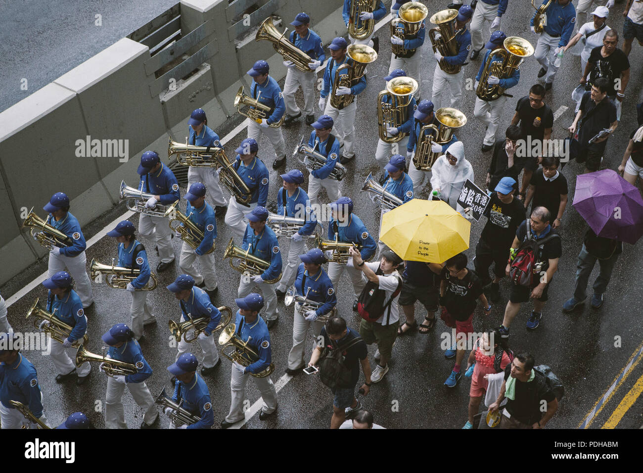 Hong Kong, Hong Kong. 1st July, 2017. A marching band seen joining the crowd of demonstrators.Thousands came together and demonstrated to mark the 20th anniversary of the Handover from Britain to China, Hong Kong's return to China on July 1st 1997. The protestors marched through sun and rain from Victoria Park to Admiralty, taking a stand on a variety of human-rights-related causes. Credit: Viola Gaskell/SOPA Images/ZUMA Wire/Alamy Live News - Stock Image