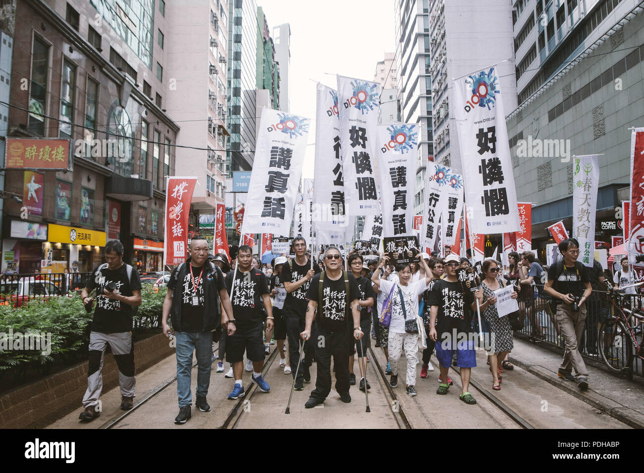 Hong Kong, Hong Kong. 1st July, 2017. Thousands of demonstrators seen marching through the streets of Hong Kong.Thousands came together and demonstrated to mark the 20th anniversary of the Handover from Britain to China, Hong Kong's return to China on July 1st 1997. The protestors marched through sun and rain from Victoria Park to Admiralty, taking a stand on a variety of human-rights-related causes. Credit: Viola Gaskell/SOPA Images/ZUMA Wire/Alamy Live News - Stock Image