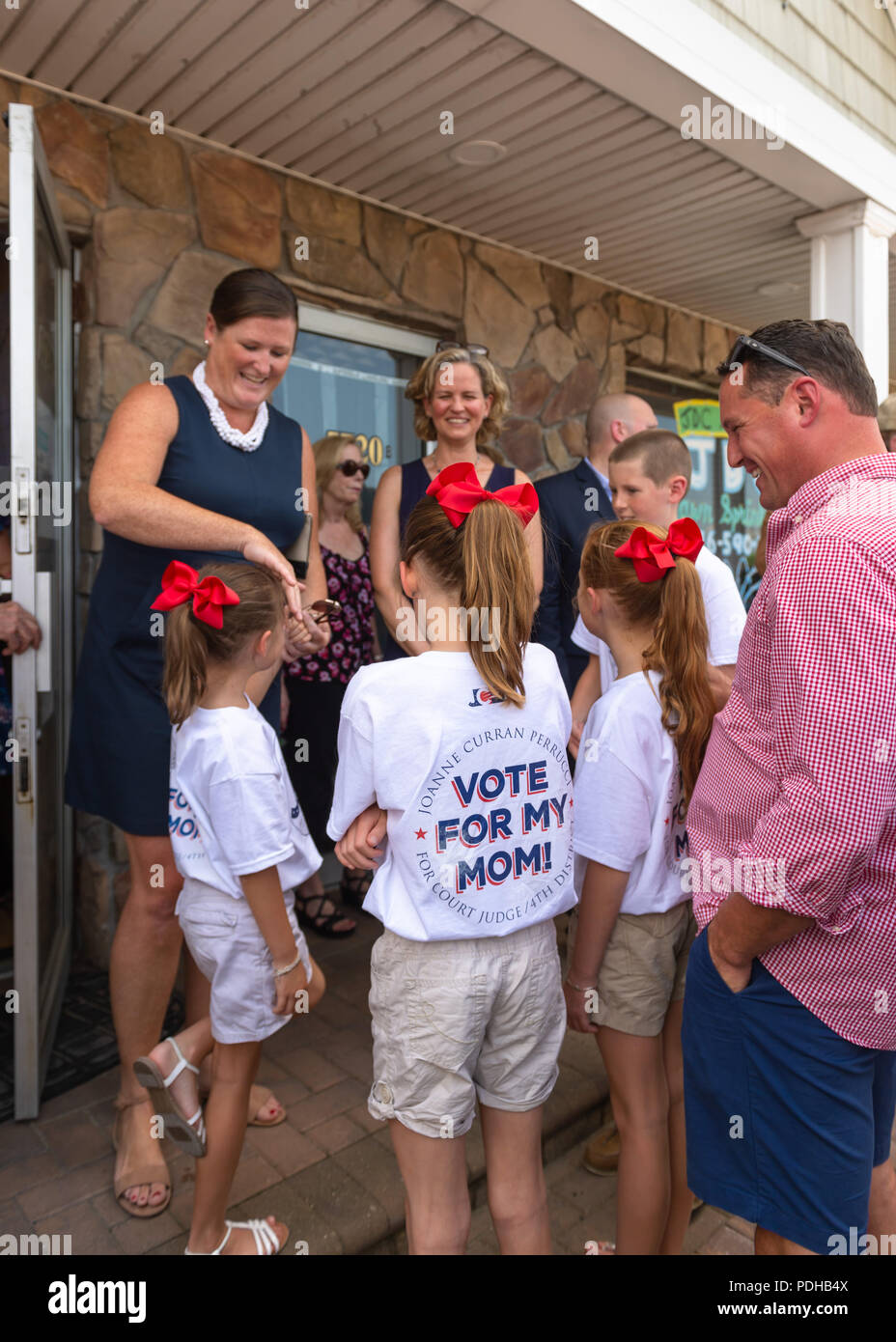 Massapequa, New York, USA. 5th Aug, 2018. Massapequa, New York, USA. August 5, 2018. L-R, JOANNE CURRAN PERRUCCI, candidate for Court Judge 4th District; and LAURA CURRAN, Nasssau County Executive, are smiling with Perrucci's four children, at opening of fellow Democrats' campaign office, aiming for a Democratic Blue Wave in November midterm elections. Credit: Ann Parry/ZUMA Wire/Alamy Live News - Stock Image
