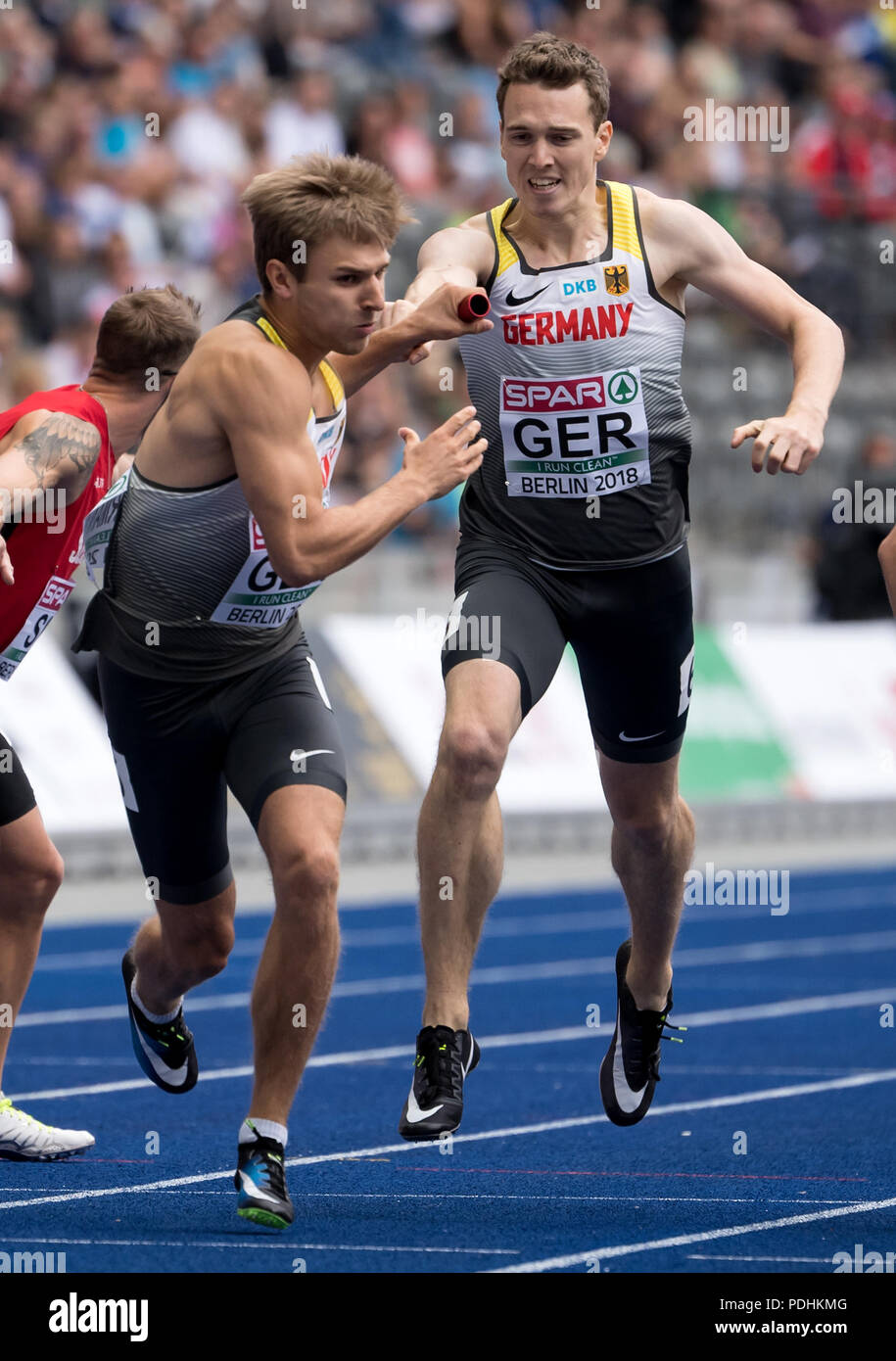 Berlin, Germany. 10th Aug, 2018. European Athletics Championships at the Olympic Stadium: 4x400 Meter Relay, Men, Round 1: Torben Junker (R) passes the baton to Fabian Dammer from Germany. Credit: Sven Hoppe/dpa/Alamy Live News - Stock Image