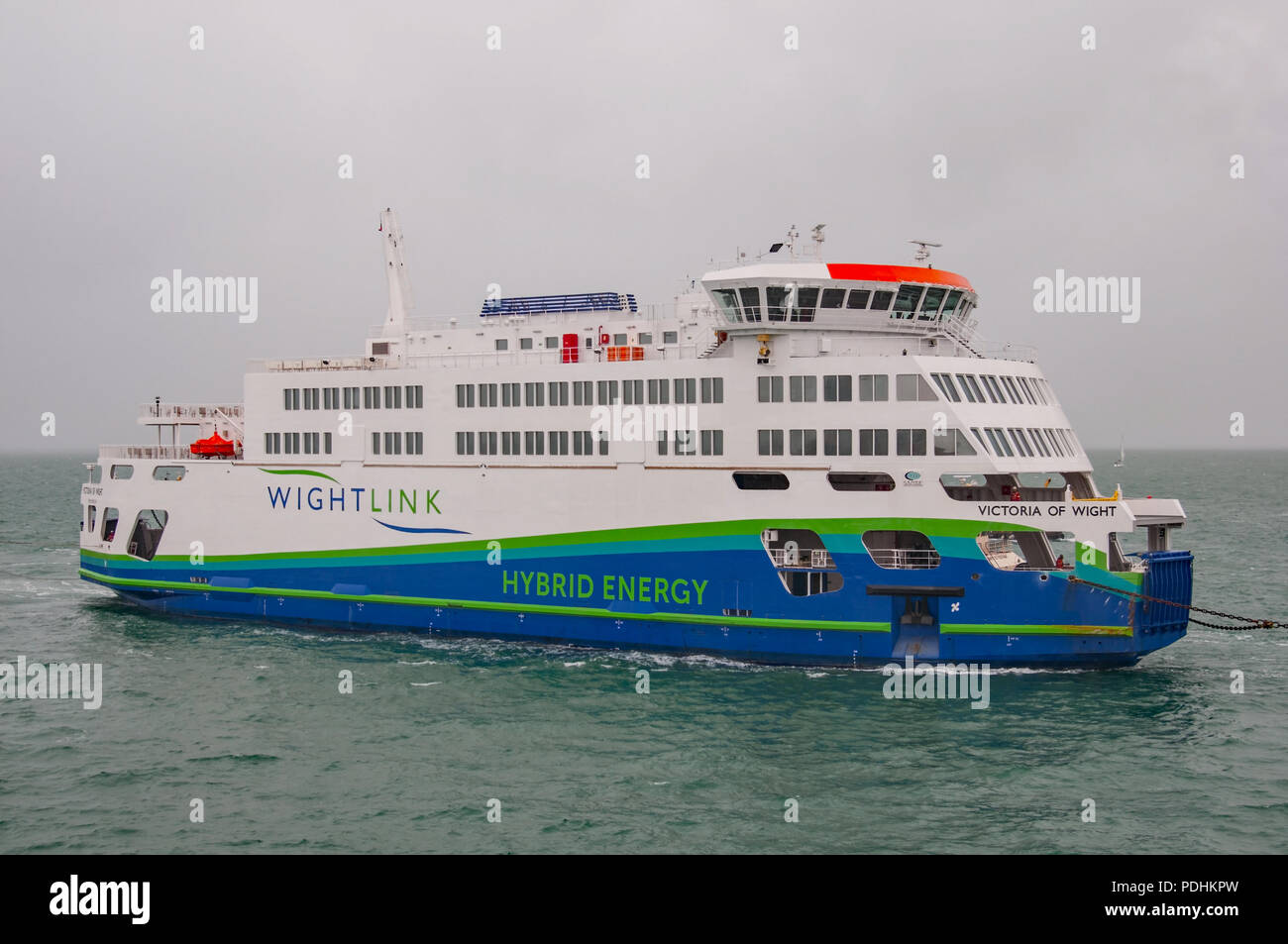 Portsmouth, UK. 10th August, 2018. The new Wightlink Isle of Wight (IOW) car / vehicle ferry MV Victoria of Wight, powered by hybrid energy, has arrived in the UK to be greeted by strong winds and torrential rain. Credit: Neil Watkin / Alamy Live News Stock Photo