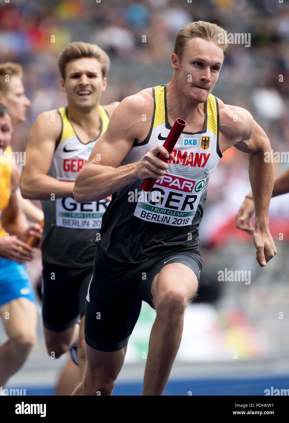 Berlin, Germany. 10th Aug, 2018. European Athletics Championships at the Olympic Stadium: 4x400 Meter Relay, Men, Round 1: Fabian Dammer (L) passes the baton to Johannes Trefz from Germany. Credit: Sven Hoppe/dpa/Alamy Live News - Stock Image