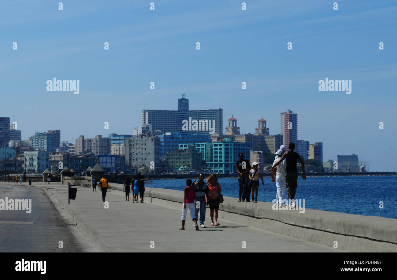 Cuban people at the Malecon in Havanna City. Stock Photo