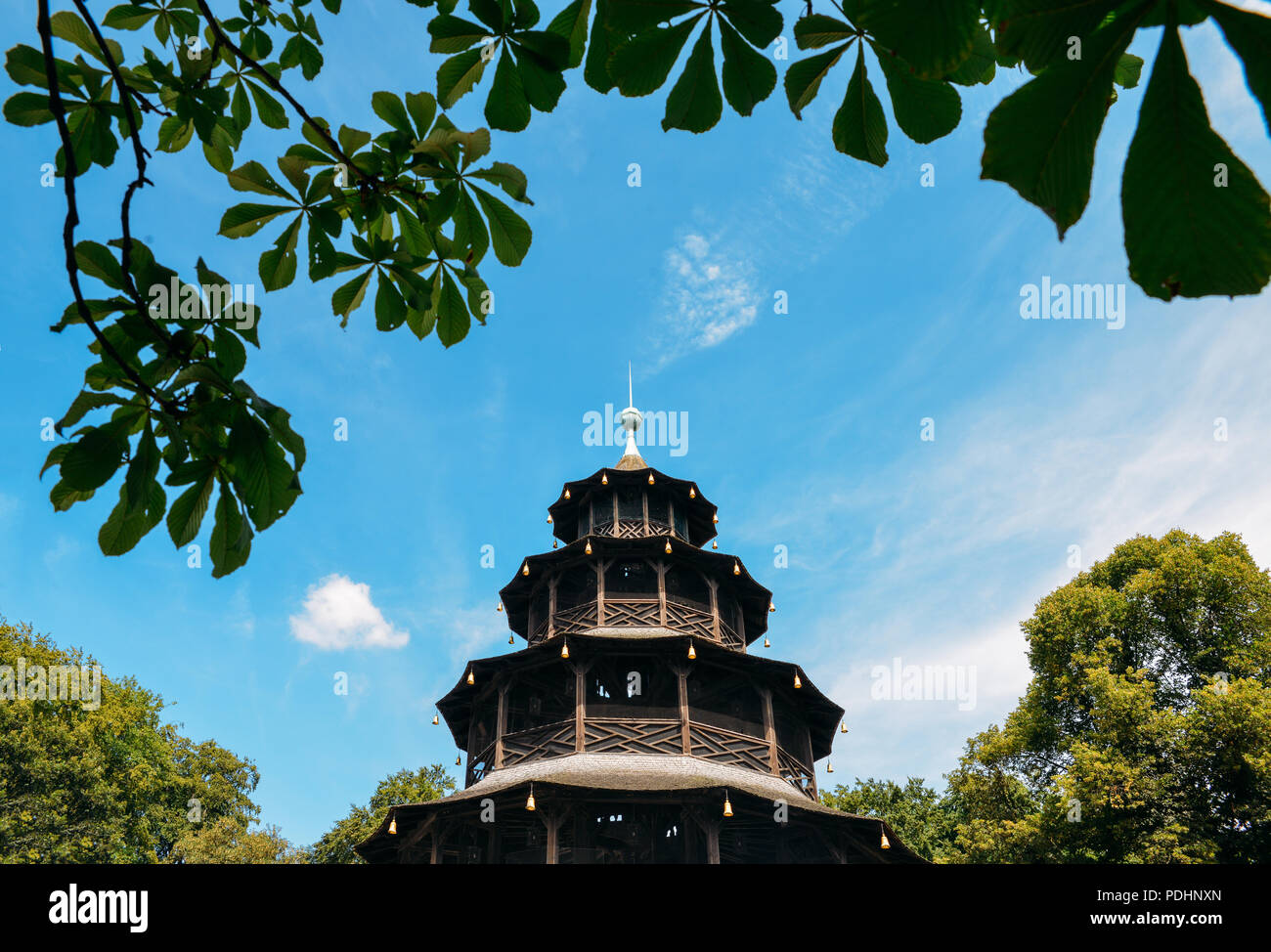 Munich, Germany - July 29, 2018: Frame of Chinese tower in English gardens in Munich in Bavaria in Germany with blue sky - Stock Image
