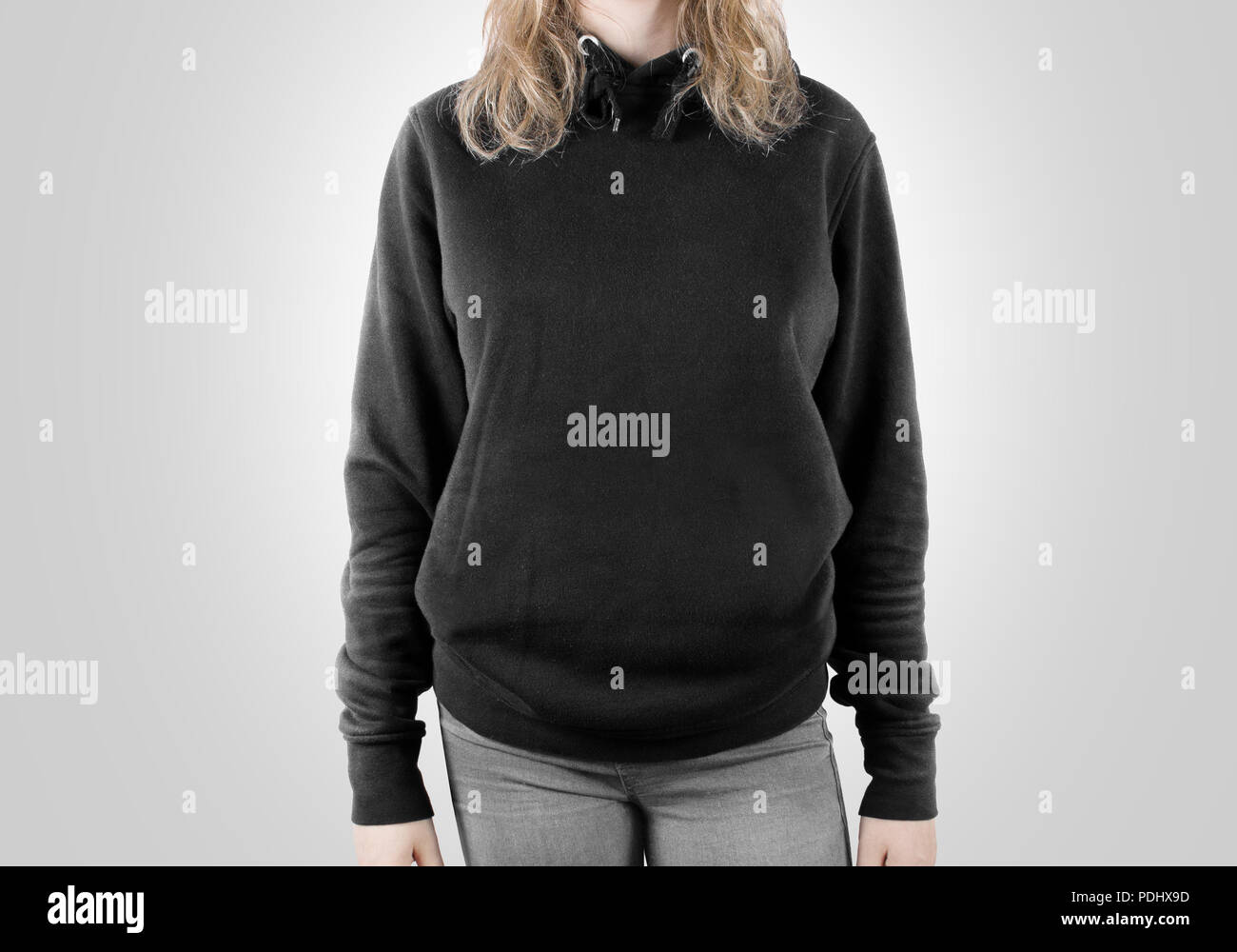 Blank black sweatshirt mock up isolated. Female wear dark hoodie mockup. Plain hoody design presentation. Clear gray loose overall model. Pullover for print. Man clothes grey sweat shirt template. - Stock Image