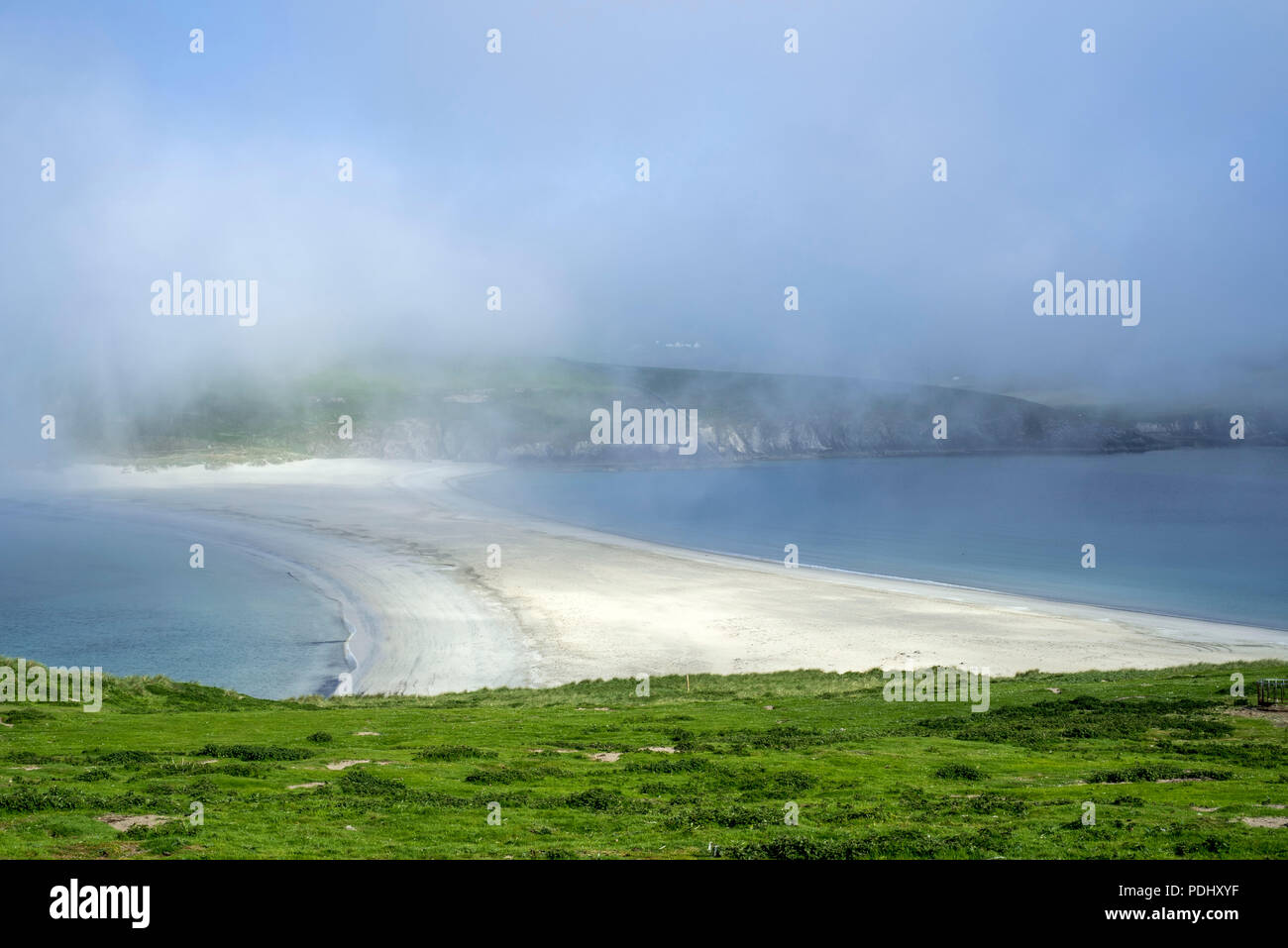 View over sandbar in the mist from St Ninian's Isle, largest tombolo in the UK, Dunrossness, Mainland, Shetland Islands, Scotland, UK - Stock Image