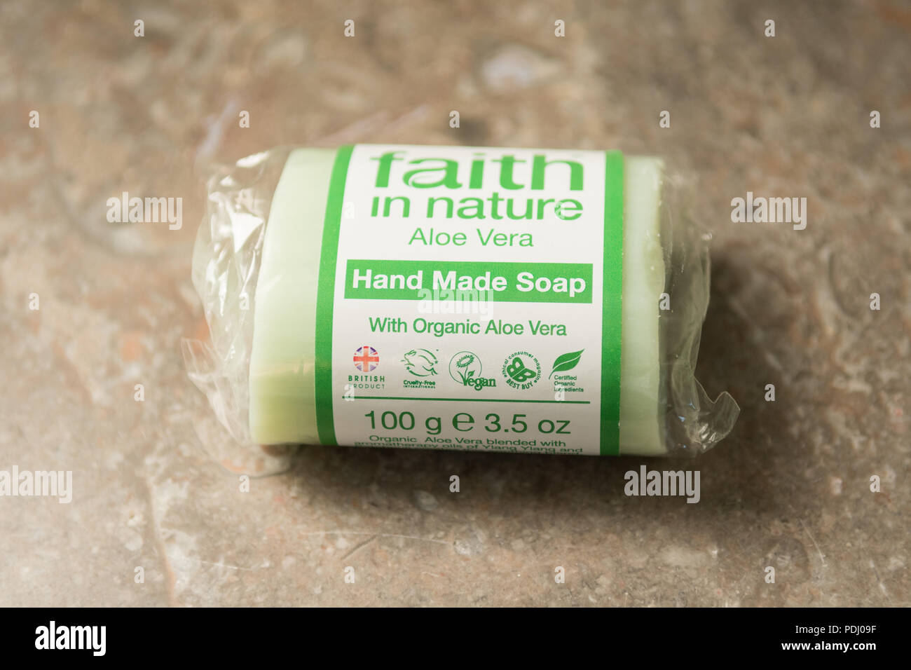 ethical consumer product - Faith in Nature solid soap bar information label - cruelty free, organic, vegan symbols - Stock Image