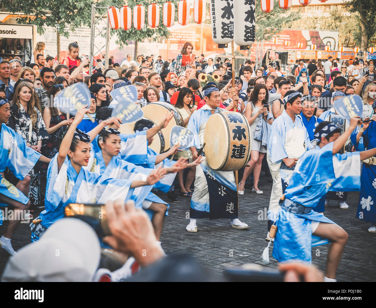Moscow, Russia - August 09, 2018: Traditional japenese Awa Dance. Dancers perform the Bon Odori dance, musicians in blue kimono with big drum odaiko d Stock Photo