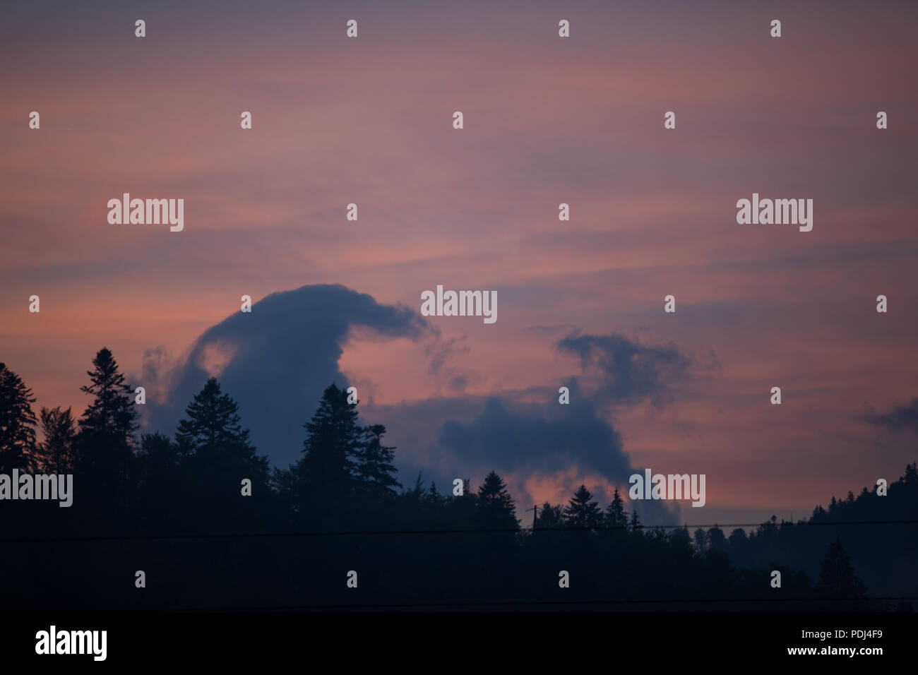 Predeal sunset, funny clouds - Stock Image