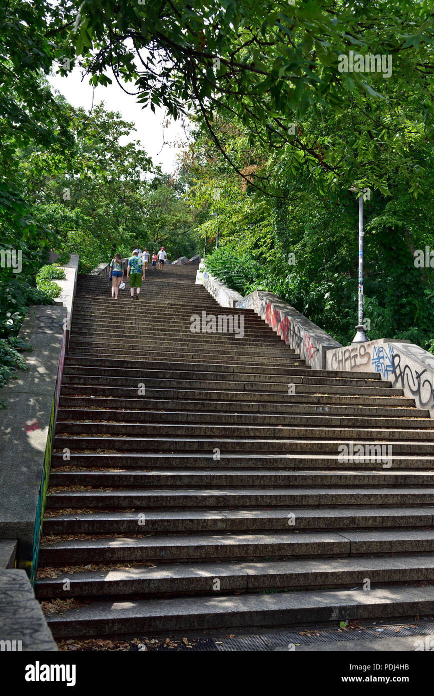Long flight of outdoor stairs going up to Prague Metronome from river Stock Photo