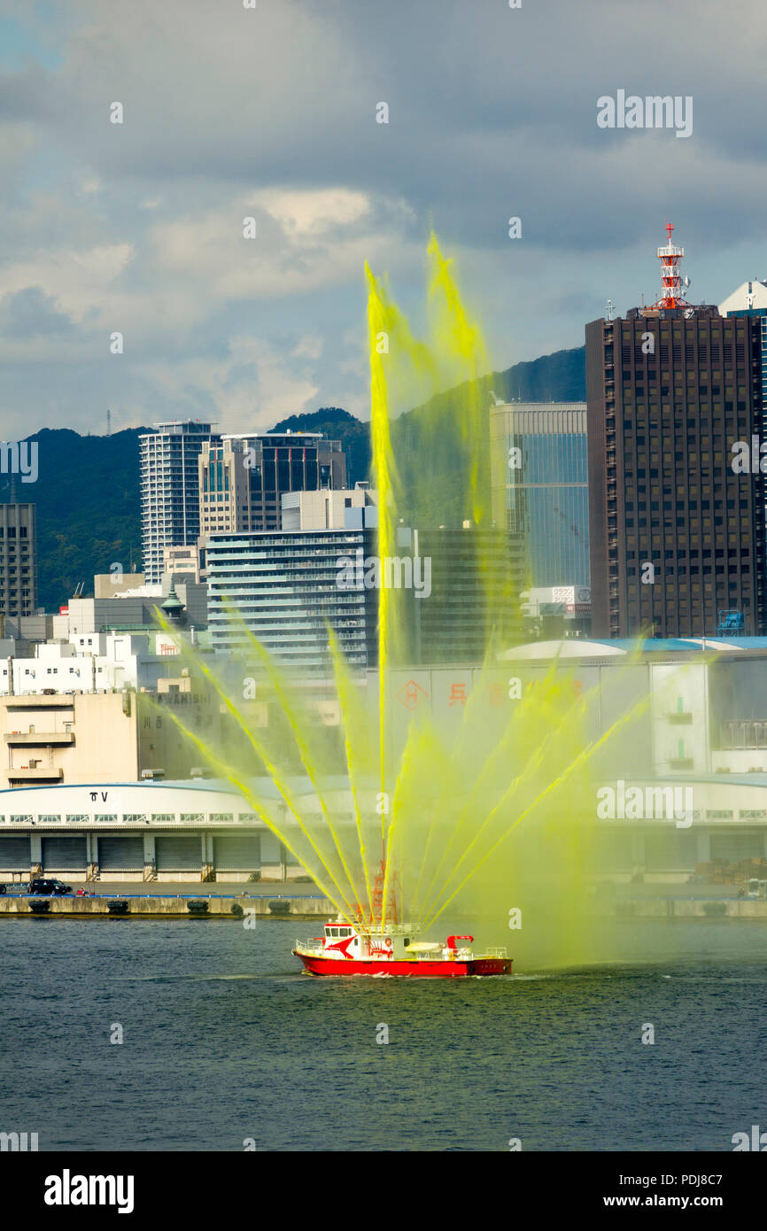 Fireboat Kobe Japan skyline from port Asia - Stock Image