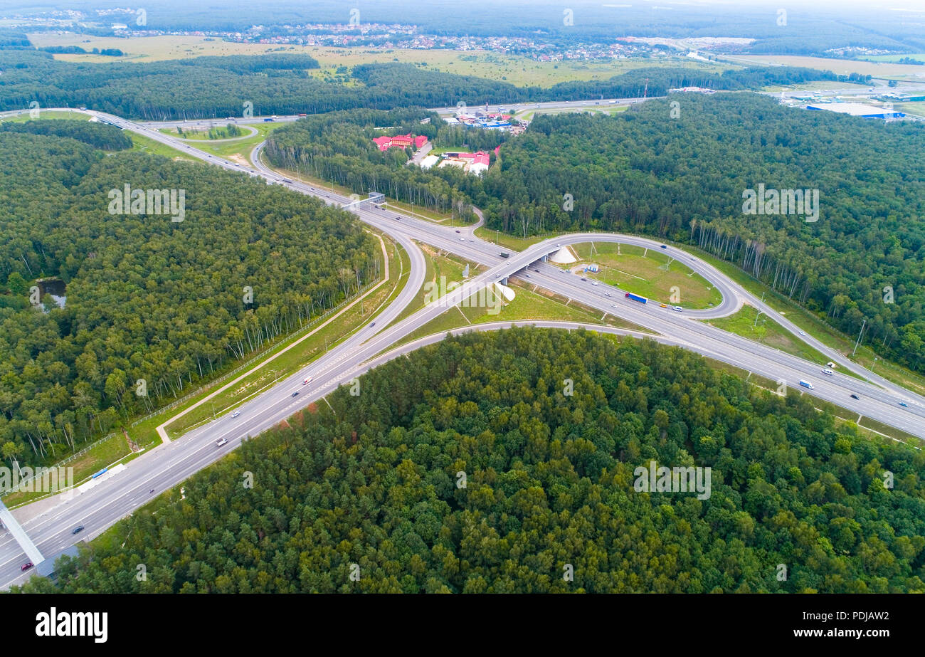 A view from above of the road, road junctions and cars. Aerial photography. - Stock Image