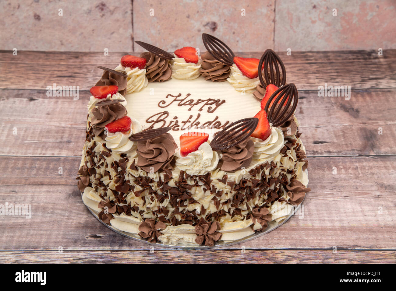 Birthday Cake Covered With Cream Strawberries And Chocolate