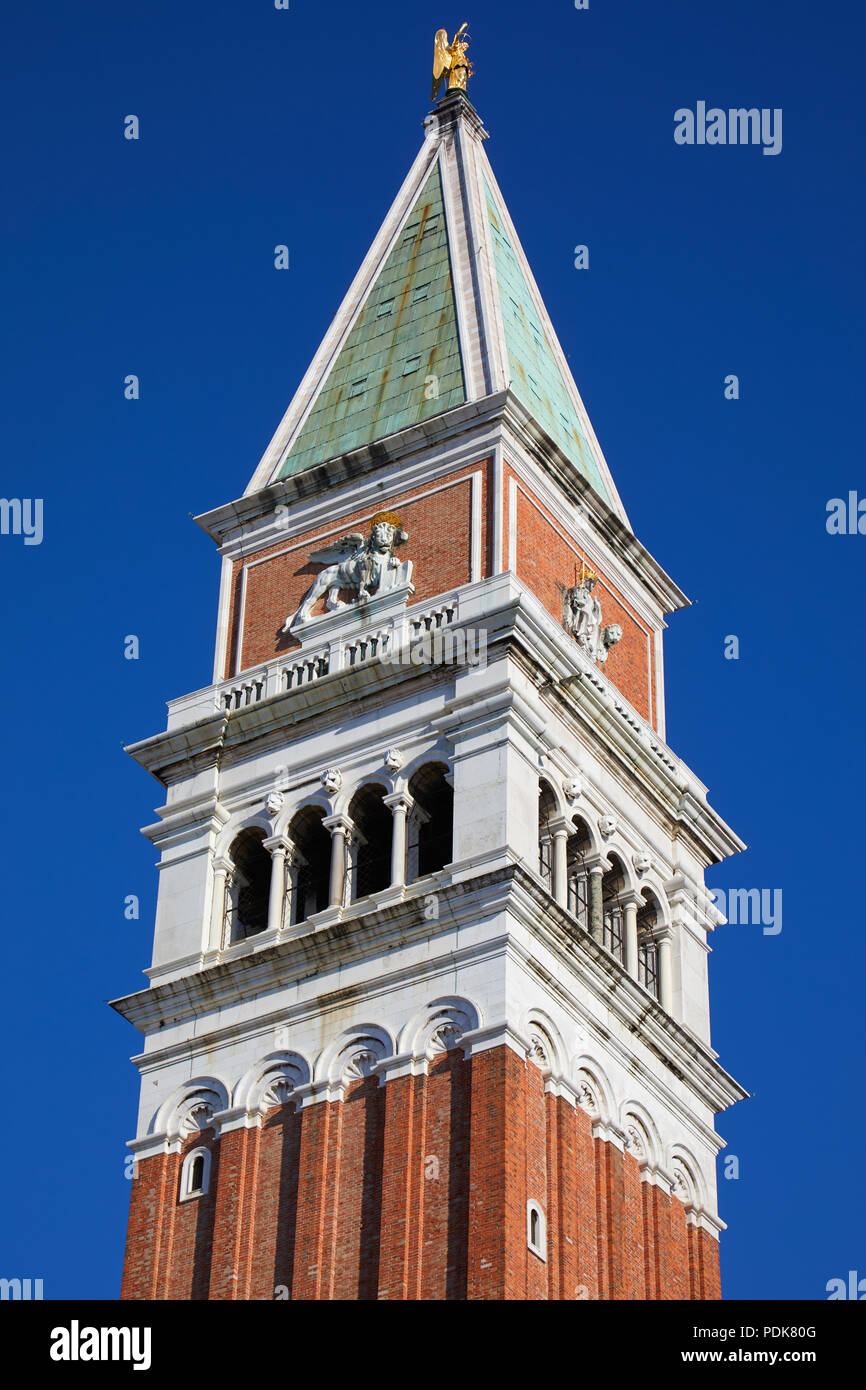 San Marco bell tower close up in Venice in a sunny summer day, blue sky - Stock Image