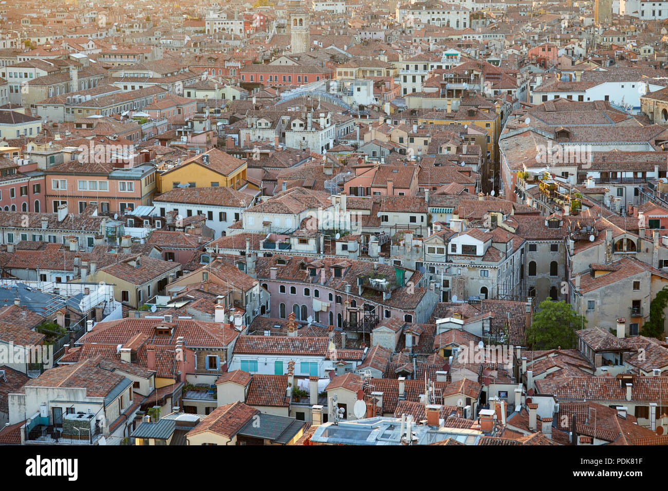 Aerial view of Venice roofs, city and buildings before sunset in Italy Stock Photo
