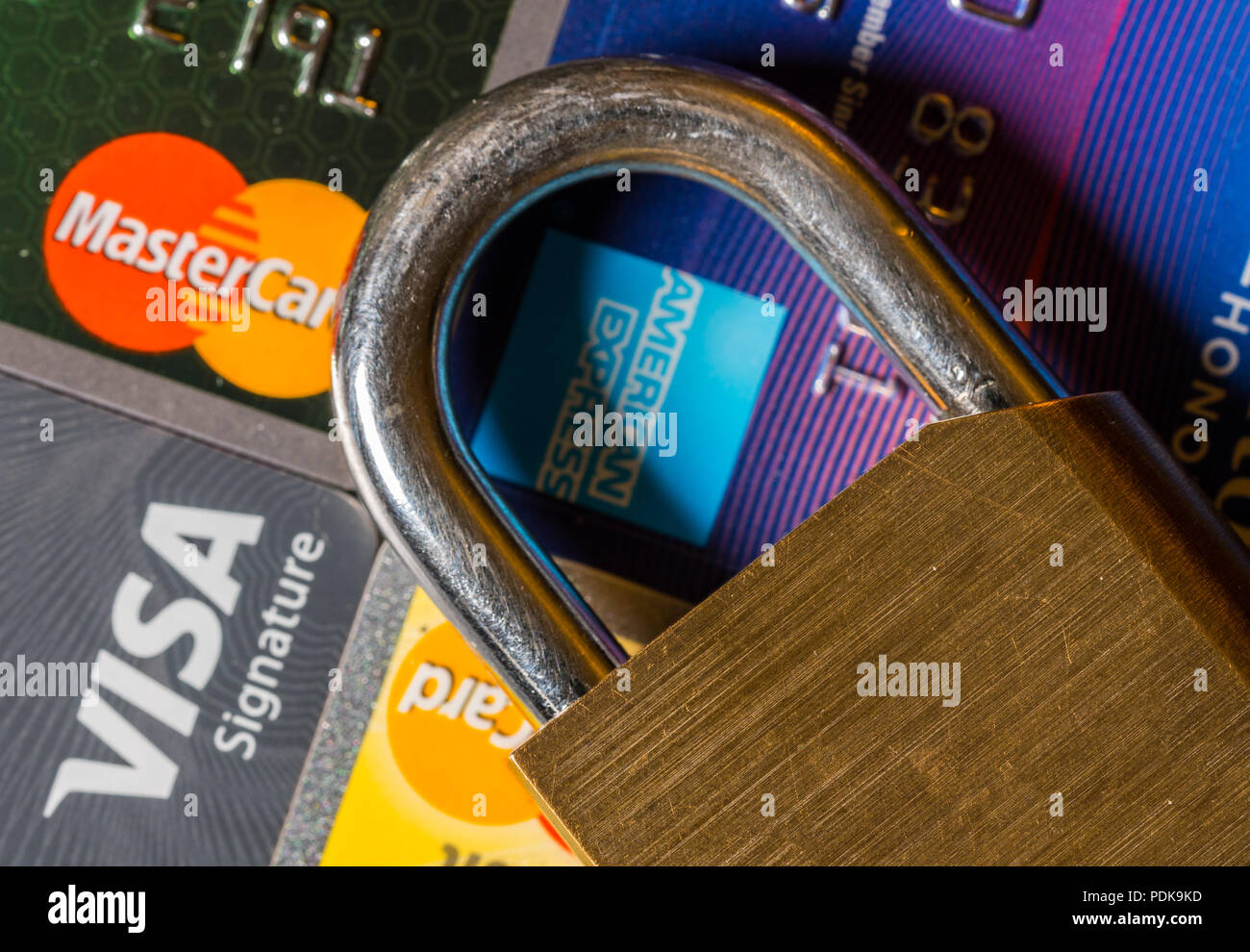 Concept for credit lock or freeze using padlock - Stock Image