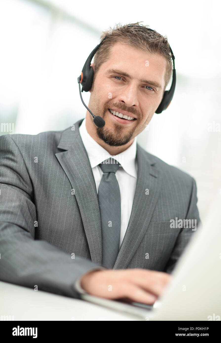 young agent of the call center with the headphones. - Stock Image