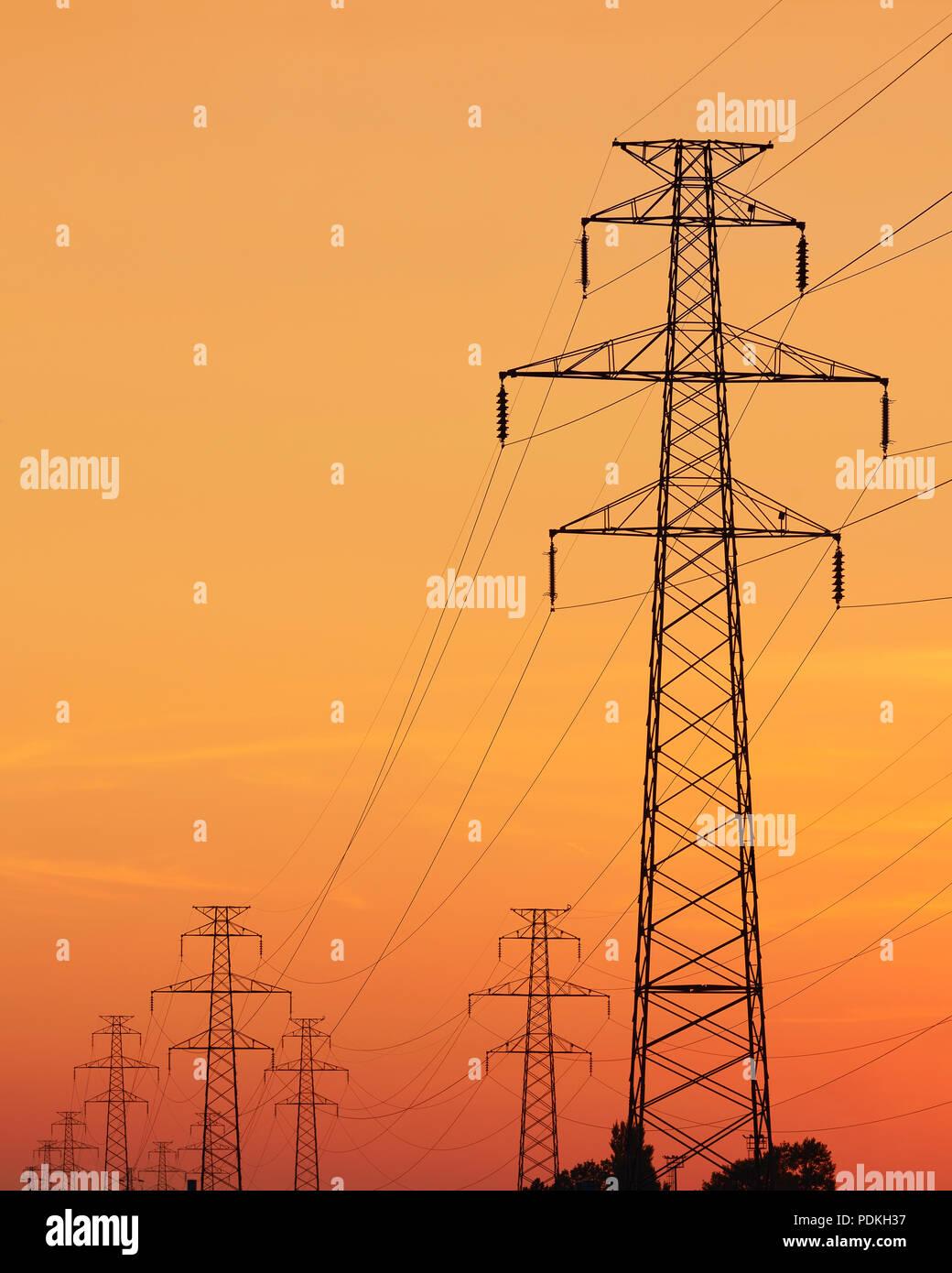 Electricity Pylon at Sunset - Stock Image