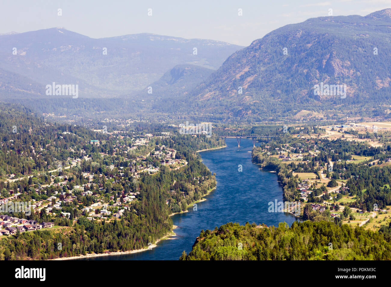 View of the Columbia River and Selkirk Mountains in Castlegar, West Kootenay, British Columbia, Canada. - Stock Image