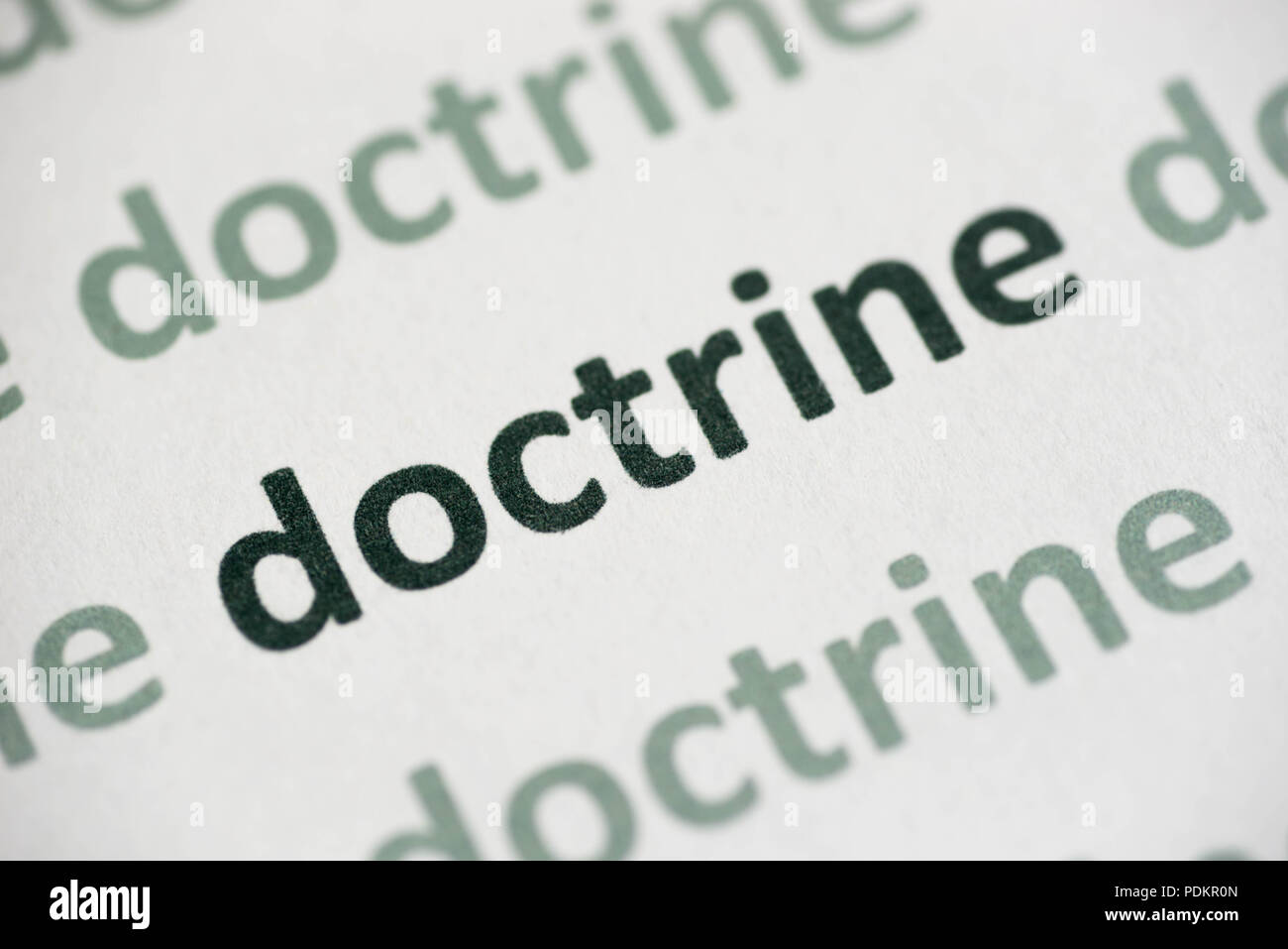 word doctrine  printed on white paper macro - Stock Image