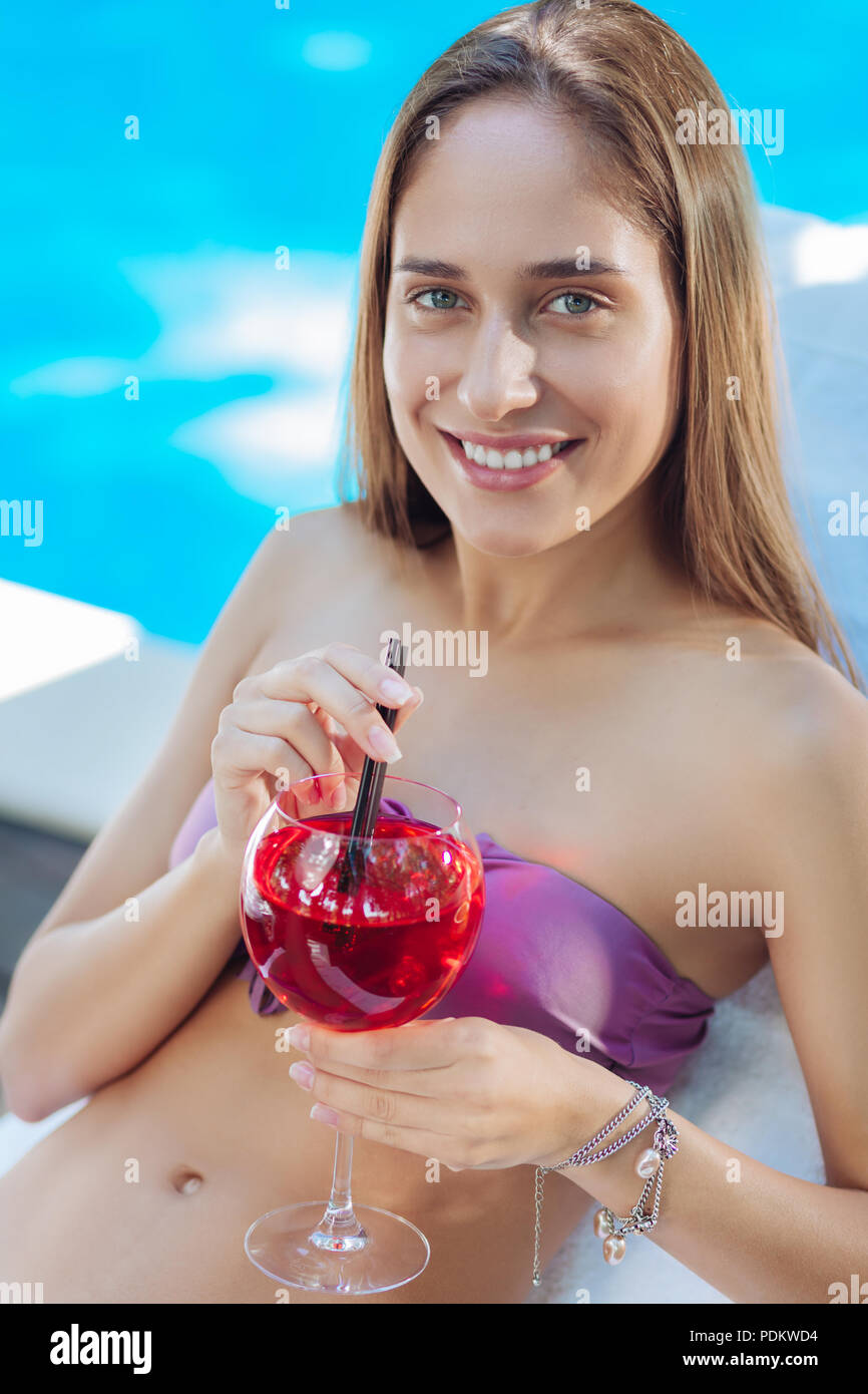 Dark-haired woman wearing stylish swimming suit and accessories - Stock Image