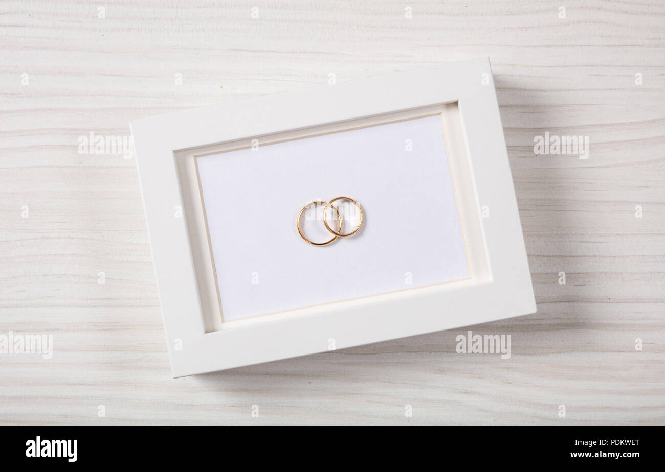 Love and marriage concept. Golden wedding rings on a blank white ...