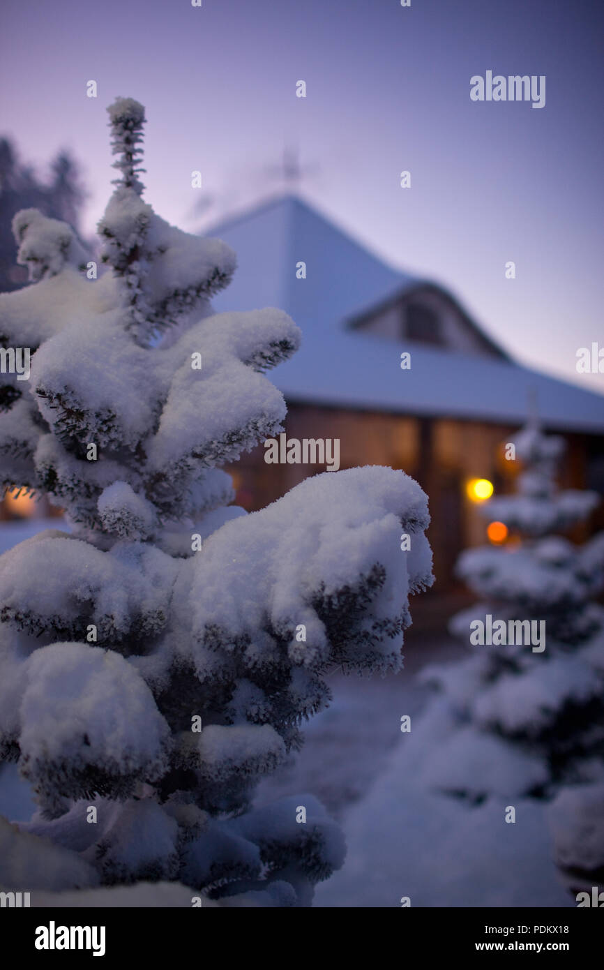 Winter Christmas landscape with smoke from the chimney house. Latvia ...