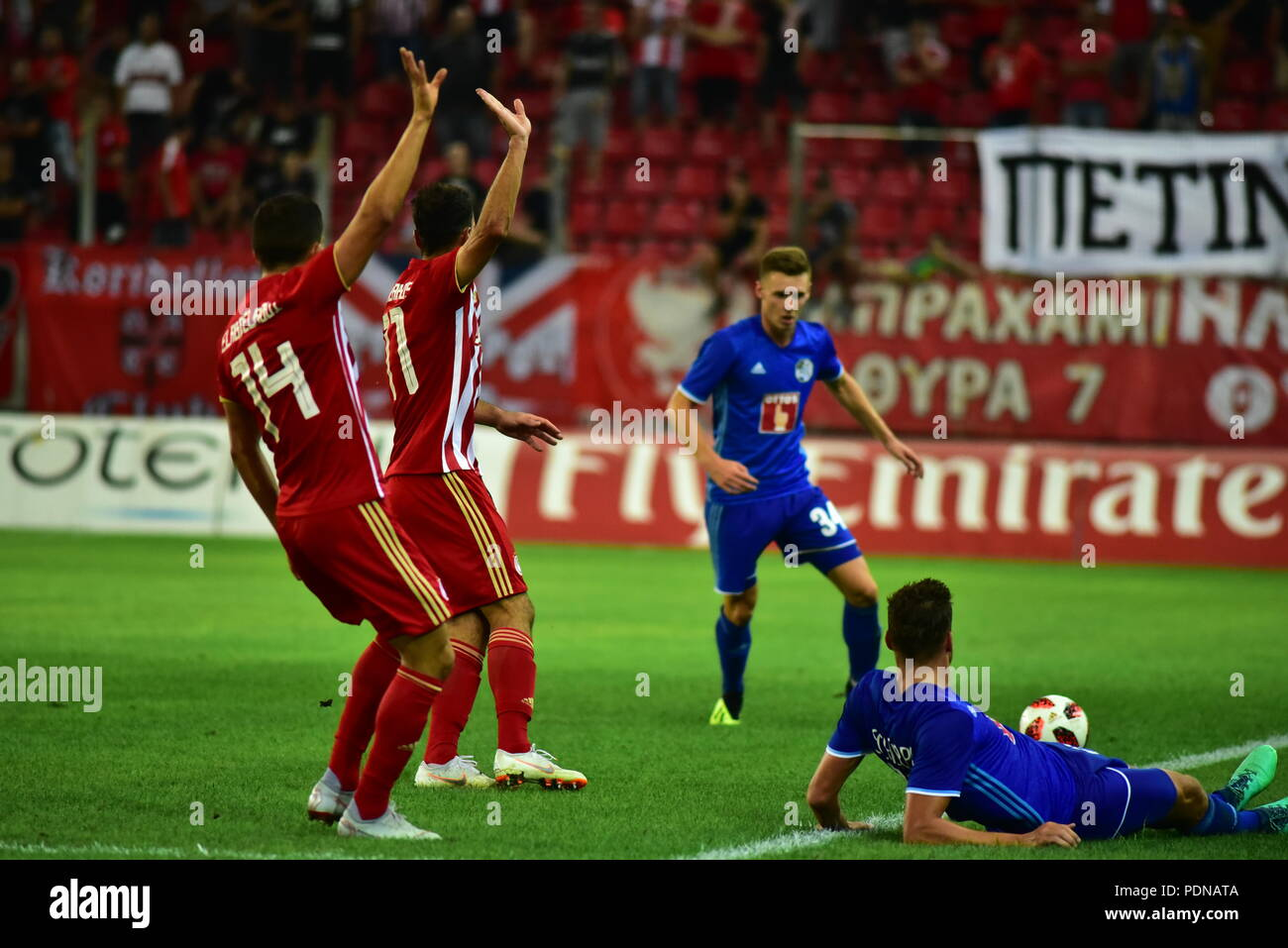 Piraeus, Greece. 09th Aug, 2018. Lazaros Christodoulopoulos (no 11) and Omar Elabdellaoui (no 14) of Olympiacos, point out that the ball possession is for Olympiacos. Credit: Dimitrios Karvountzis/Pacific Press/Alamy Live News - Stock Image