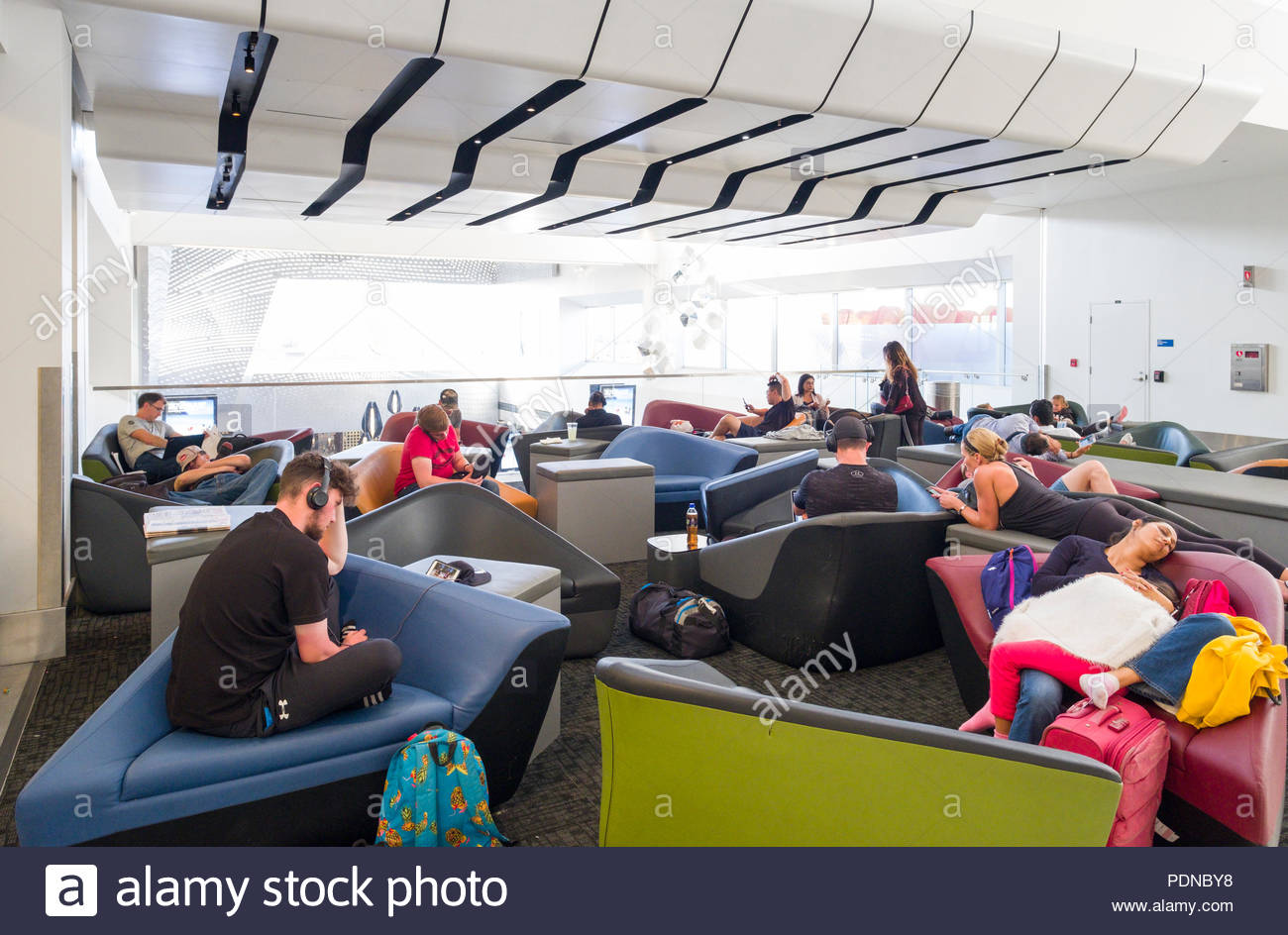 Passengers resting on sofas in Terminal 2, Los Angeles International Airport, Los Angeles, California, USA - Stock Image