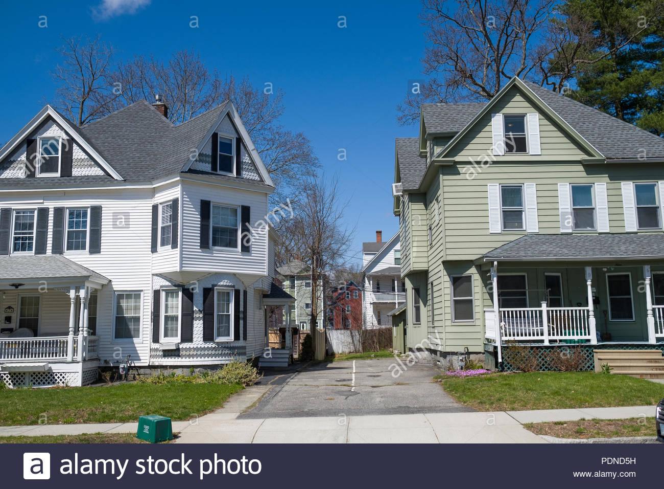 Multistory houses along street in Worcester, Massachusetts, USA - Stock Image