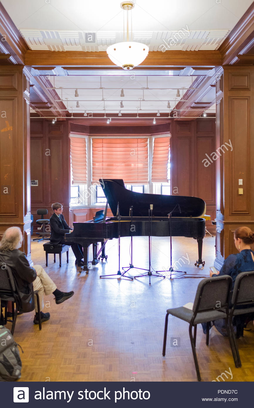 Young man performing recital on grand piano as part of his final project, recital hall, Alden Memorial auditorium, Worcester Polytechnic Institute, Wo - Stock Image