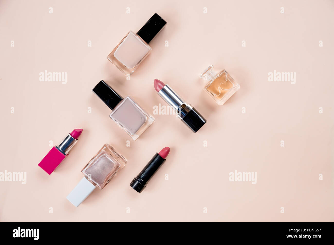 cosmetic set. Isolated on pastel background.Bottle of perfume and cosmetic products on color background.Decorative cosmetics and tools of professional makeup artist.Women's cosmetics. - Stock Image