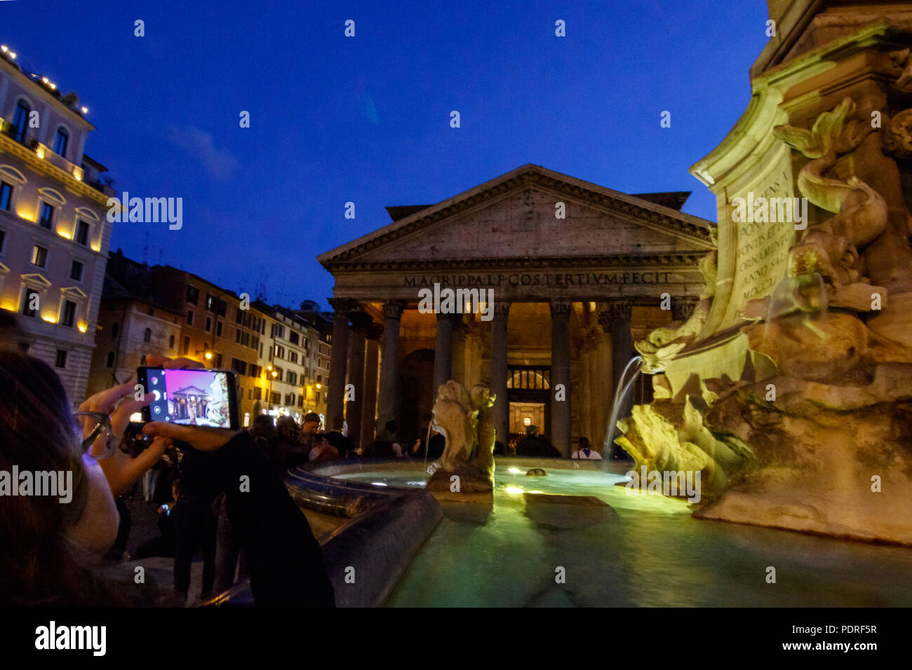 A tourist taking a photo of the Pantheon at night, Rome, Italy. - Stock Image