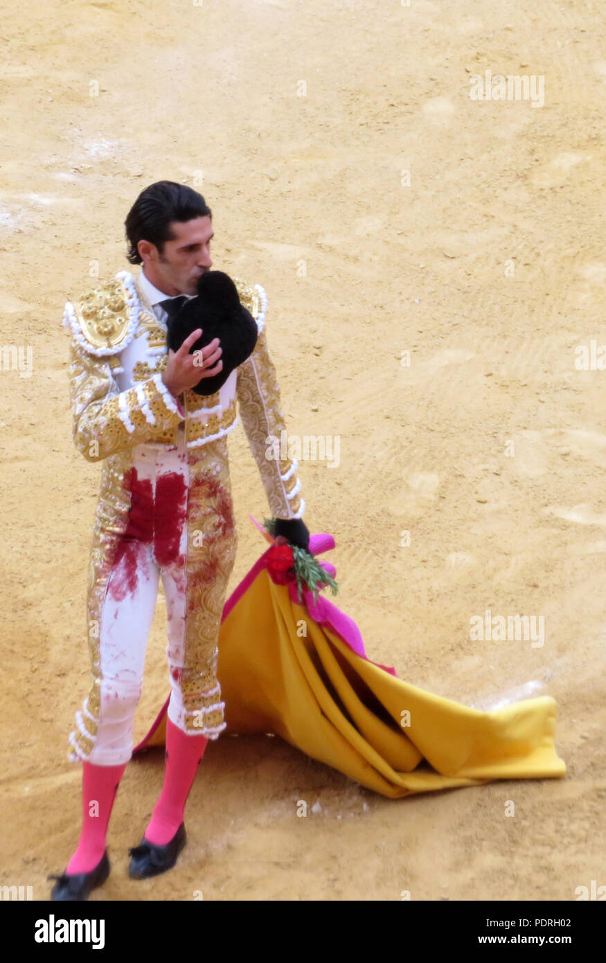 Bull fighter Talvante-Bloodstained. ' Victorious After The Kill'. Matador in the Plaza de Toros Granada, Andalusia, Spain. Spanish culture/tradition. - Stock Image