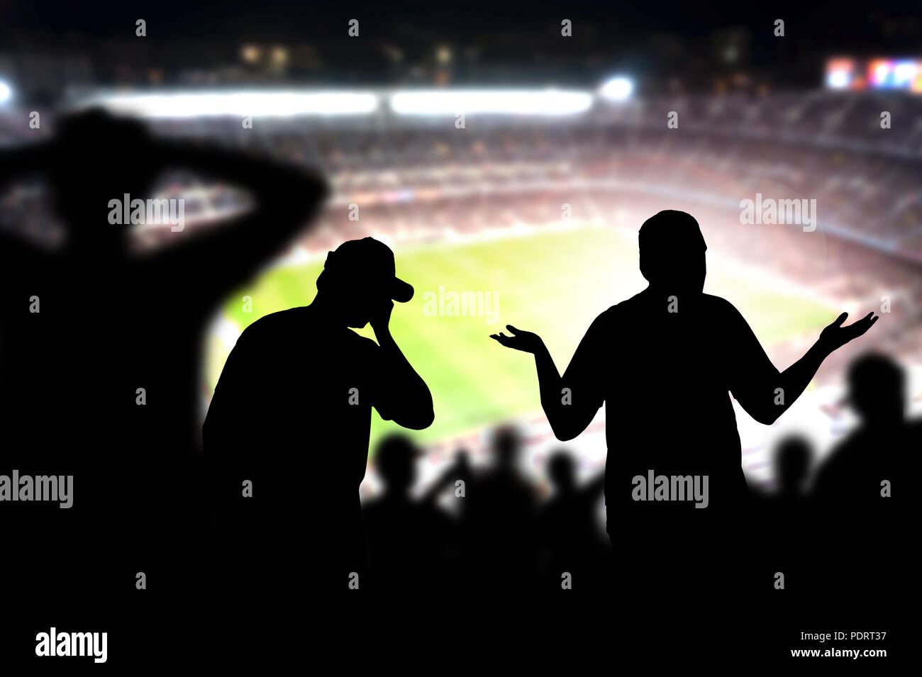 Sad football fans. Disappointed, angry and upset crowd in a match in a soccer stadium. Favourite team and club lost game. Devastated audience. - Stock Image