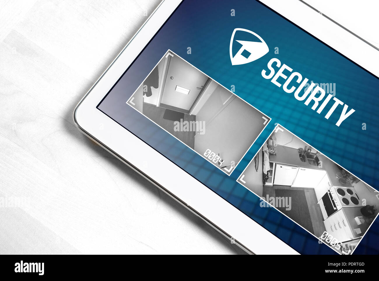 Home security system and application in tablet. Protection and surveillance camera live footage inside a house or apartment. Smart cctv and safety app - Stock Image