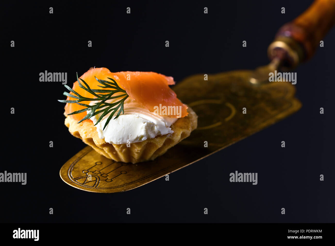 Canapes with smoked salmon or trout , cream cheese and dill . Tasty snack. Seafood. - Stock Image
