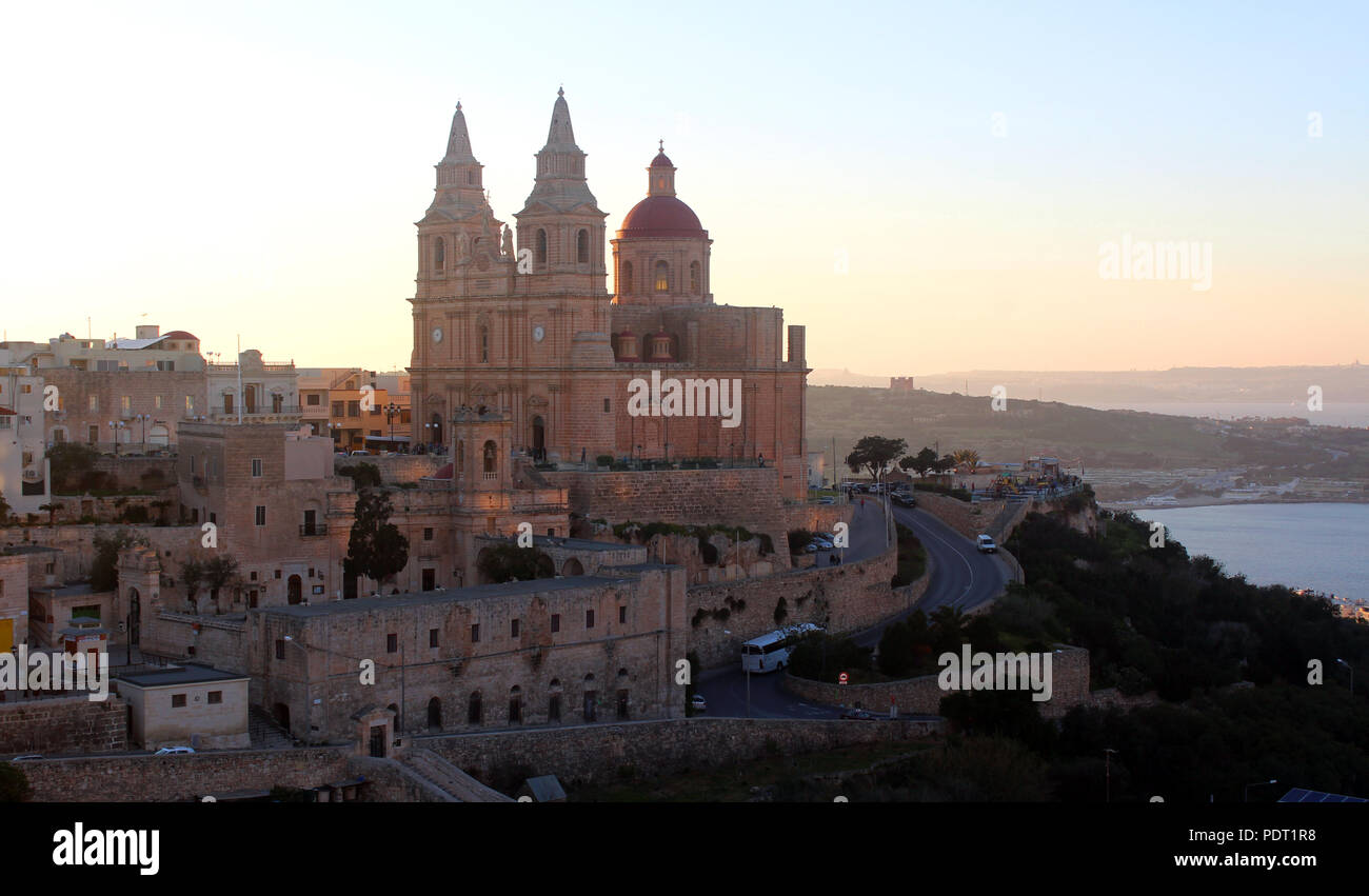 Mellieha, Malta, with its church, at sunset - Stock Image