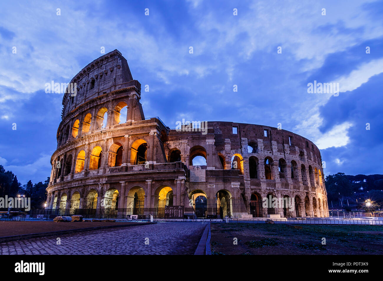 A view at the blue hour of the Colosseum, Ancient Roman Forum, UNESCO World Heritage Site, Rome, Italy. - Stock Image