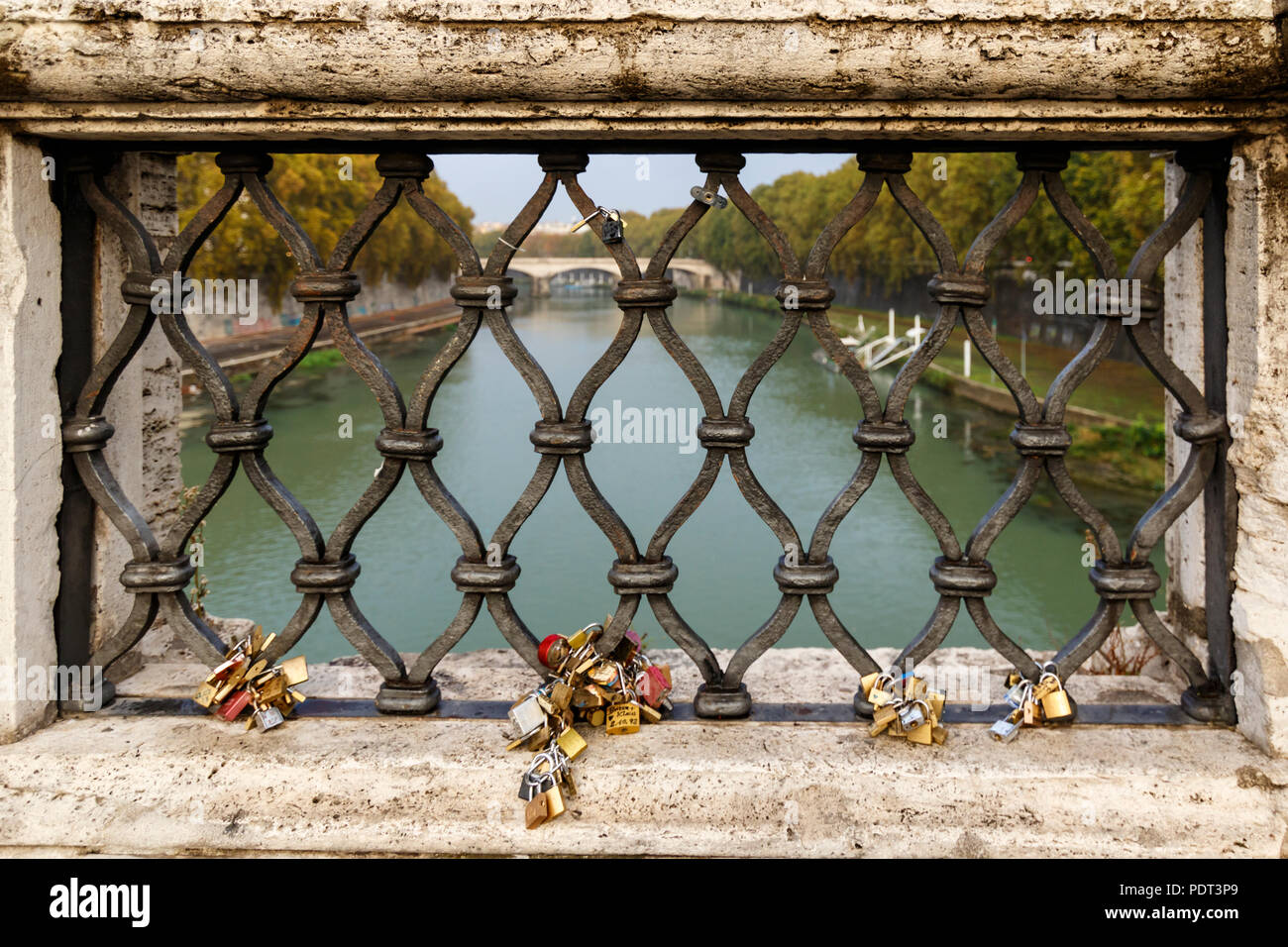 Lovers tie their love forever with the padlocks at St. Angelo's Bridge in Rome, Italy. - Stock Image