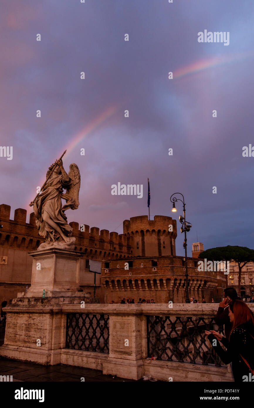The Angel with the Lance of Ponte Sant'Angelo pointing at the rainbow. Rome, Italy. - Stock Image